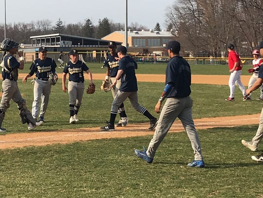 Hackensack baseball players rush to congratulate pitcher