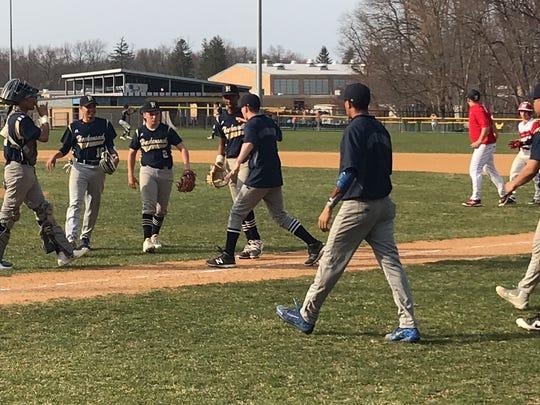 Hackensack baseball players rush to congratulate pitcher