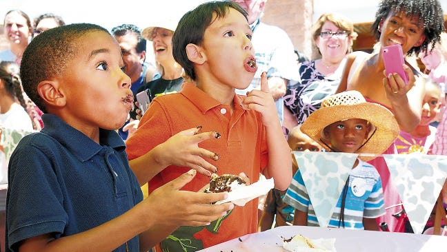 Two young contestants participate in the Ice Cream Sunday Ice Cream Sandwich Eating Contest. This year's annual event at the New Mexico Farm & Ranch Heritage Museum is set for noon to 4 p.m. Sunday.