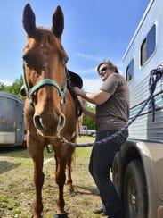 Sherry Binsfeld of Albany saddles her 23-year-old quarterhorse,