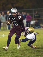 Shippensburg's Cody Gustafson (18) runs with the ball