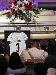 A #3 Warren Central jersey adorns the casket of football