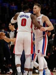 Detroit Pistons forward Blake Griffin hugs center Andre