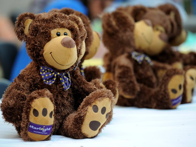 """The Teddy Bear Clinic was open at Riley Hospital for Children at IU Health, Friday, March 21, 2014, in Indianapolis. At the Teddy Bear Clinic, children at the hospital were able to step outside their role as a """"patient"""" and be a """"doctor"""" to a stuffed animal."""