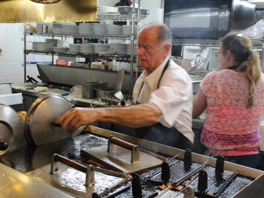 "Leroy ""Bingo"" Powell readies breakfast at the Southernaire"