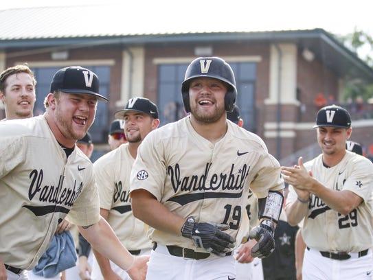 Vanderbilt catcher Stephen Scott (19) celebrates with