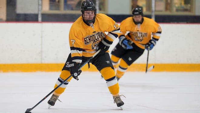 Schoolcraft College defenseman and captain Andrew Nowak (17) looks to pass the puck during the Oct. 15 game at Redford Arena.