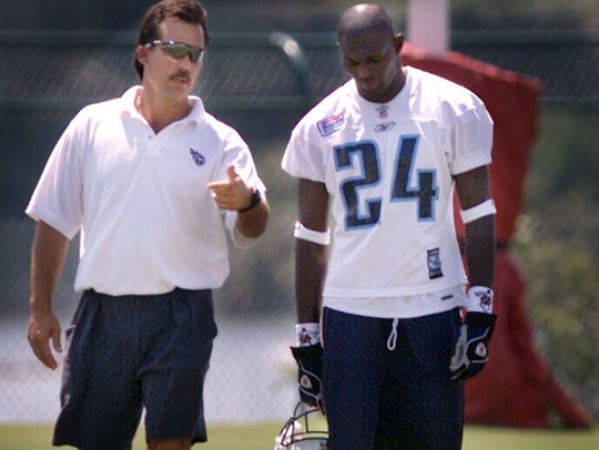 Tony Beckham, right, a former Titans player was in the news in 2019 after he told Florida police that he beat a man he found masturbating outside of his daughter's window