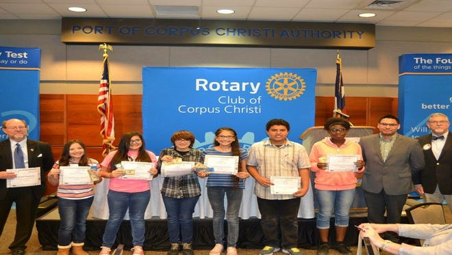 Six Driscoll Middle School students and a teacher were recognized by the Rotary Club of Corpus Christi. Pictured (from left to right) are Robert Thompson (teacher), Aubrey Cantu, Aryana Coddington, Aliyah Morales, Lilliana Torres, Jose Vega, Shaqmeka Cobb, and Tim Stephens, who is president of the Rotary Club of Corpus Christi.