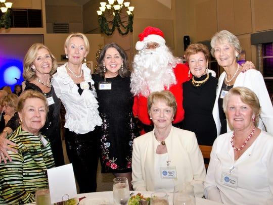 Santa Claus (aka Daryl Magill) celebrates with former