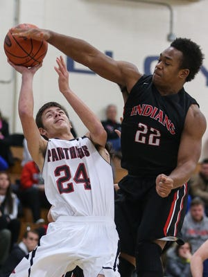 Holy Cross' Derrick Barnes blocks a shot by Ludlow's Michael Camarena on Monday.