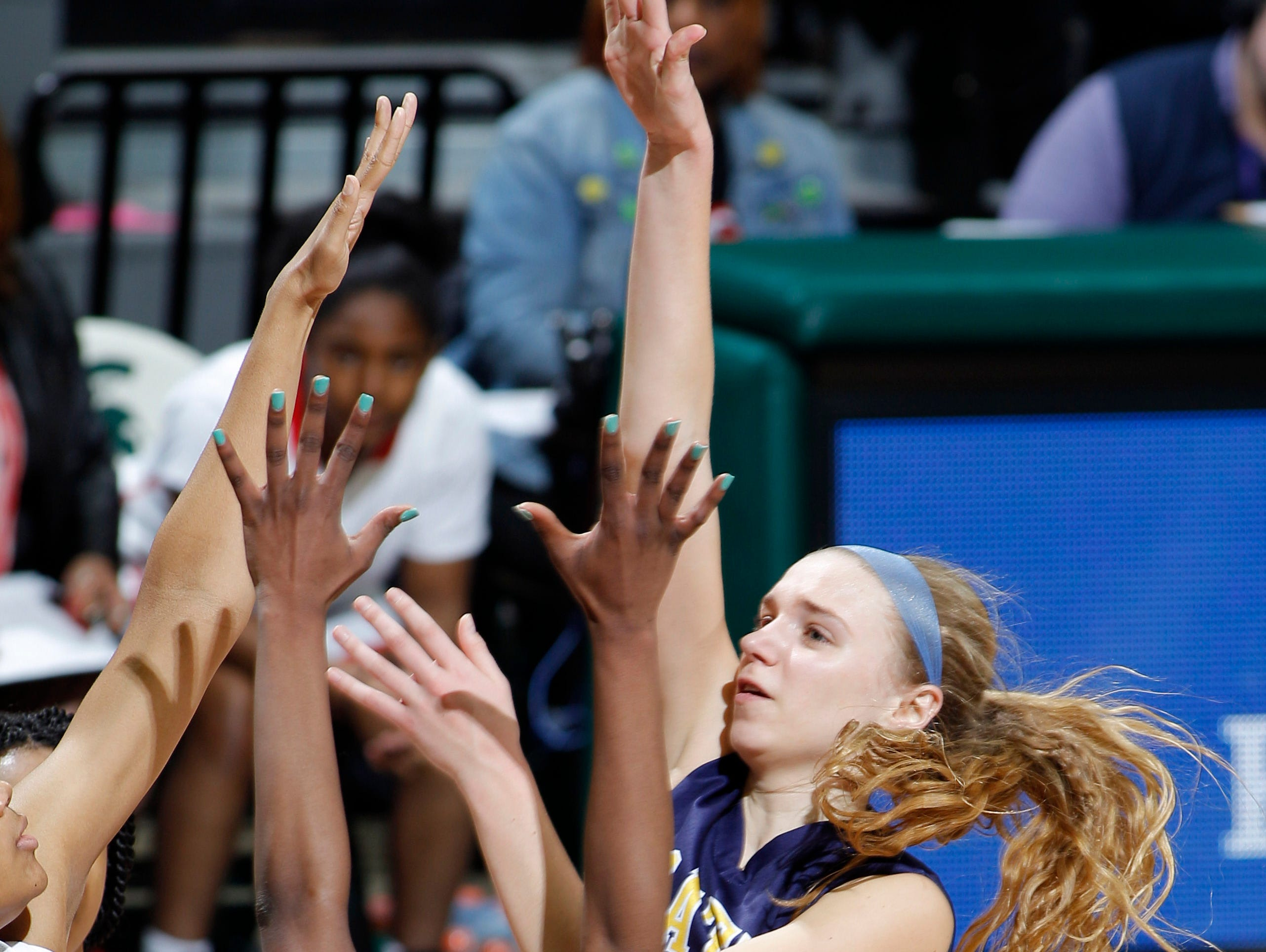 Pewamo-Westphalia's Emily Spitzley, right, shoots over Detroit Edison defenders during their MHSAA Class C championship game, Saturday, March 18, 2017, in East Lansing, Mich. P-W fell 46-44.