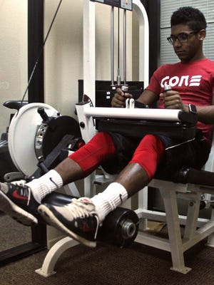 Palm Springs High School football player Franklin Miller during a treatment session for his knee injury at Eisenhower Physical Therapy in Palm Springs on Wednesday, Jan. 20, 2016.