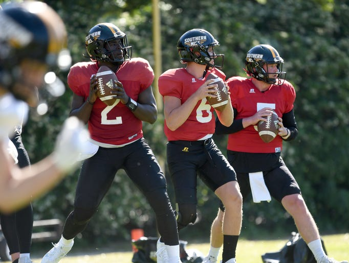 Southern Miss players runs drills during the last day