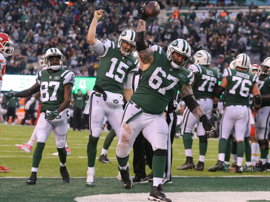 New York Jets quarterback Josh McCown reacts as guard