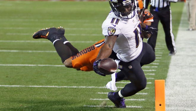 Baltimore Ravens wide receiver Kamar Aiken (11) sores after a reception in the second half of Monday's game against the Cleveland Browns.