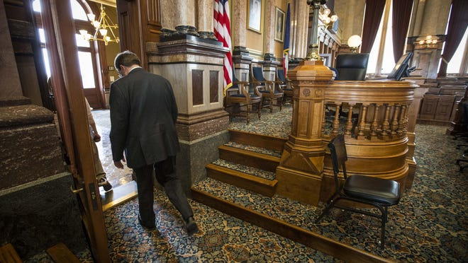 Kraig Paulsen leaves the House chambers Wednesday at the Statehouse after a press conference where he announced he will step down as Iowa Speaker of the House and not seek re-election in 2016.