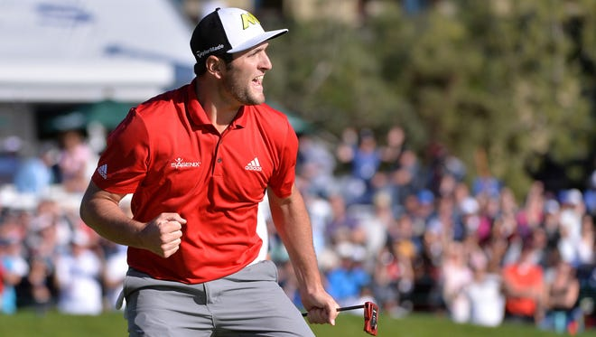 Jon Rahm celebrates after a eagle on the 18th hole during the final round of the Farmers Insurance Open golf tournament at Torrey Pines Municipal Golf Course - South Course.