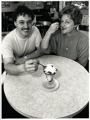 A copy of this 1989 photo of Yum Yum Tree founders