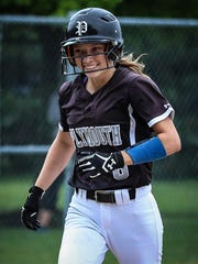Circling the bases after her home run against Salem is Plymouth's Jenny Bressler.