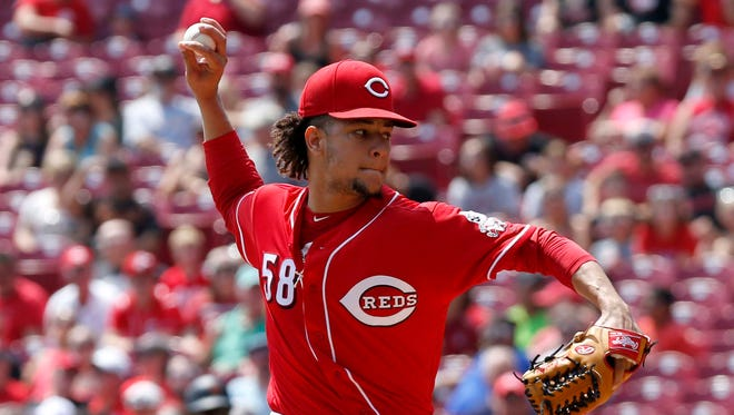 Cincinnati Reds starting pitcher Luis Castillo (58) throws against the San Francisco Giants during the first inning at Great American Ball Park.