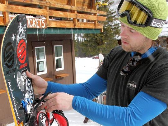 Mac Gordon, of Whitefish, demonstrates how his splitboard