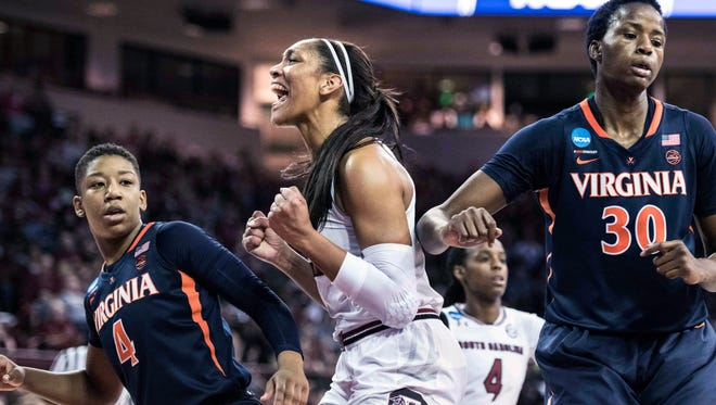 South Carolina forward A'ja Wilson, center, celebrates a basket against Virginia guard Dominique Toussaint (4) and Felicia Aiyeotan (30) during the first half of a game in the second-round of the NCAA women's college basketball tournament, Sunday in Columbia.