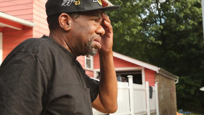 Willie Walker, talks about the previous night's shooting that occurred during a birthday party for his grandson in the backyard of the home next to his on Roselle Avenue Saturday, Aug. 15, 2020 in Akron, Ohio. An eight-year-old girl died in the shooting.