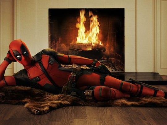 Deadpool lies on a bearskin rug.