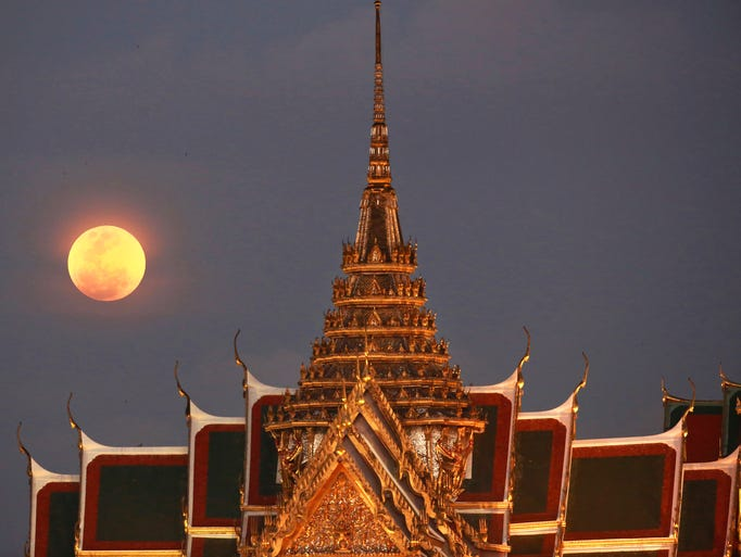 Super blue blood moon beside the Grand Palace in Bangkok,
