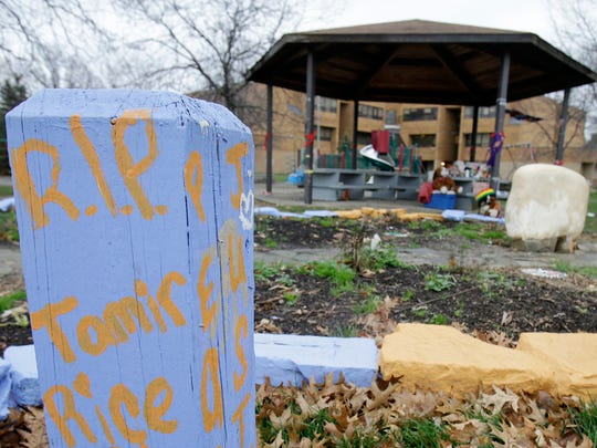 A memorial to Tamiar Rice is seen near the gazebo outside