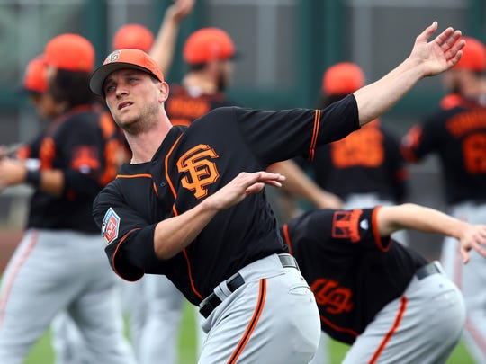 Tony Watson stretches during a spring training baseball