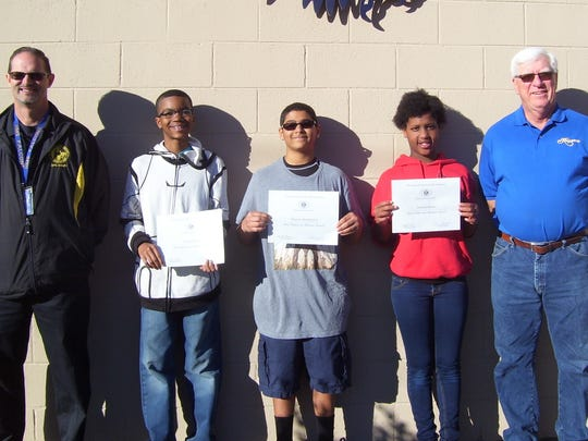 Holloman Middle School pictured left to right: Principal Steven Starkovich, Jordan Rivera, Darryus Washington, Adriana Brooks, and Kiwanis Club member Ned Kline.