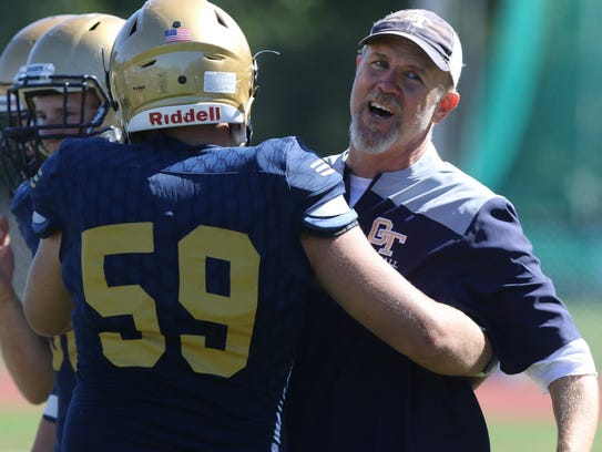 Scott Essmann of NV/Old Tappan gets a hug from a happy head coach Brian Dunn at the end of the Golden Knights' 2017 regular-season football game against Wayne Hills.