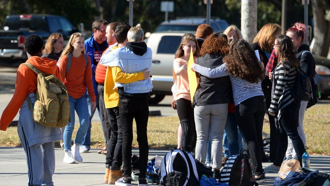 About 35 students at Sebastian River High School gathered at the flag pole Wednesday, March 14, 2018, for 17 minutes of silence to honor the 17 people killed in a school shooting at Marjory Stoneman Douglas High School in Parkland. The scene played out across the nation as part of a National School Walkout event.
