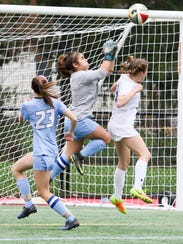West Morris junior Ava Mamary makes the save against