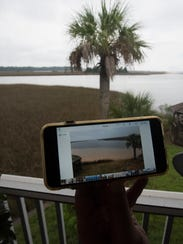 A resident of the Indian Bayou area in Milton shows