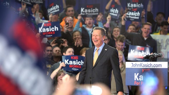 John Kasich addresses supporters at a watch party in