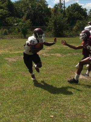 Fort Pierce Westwood running back Marques Burgess gives evades a defender during practice Wednesday.