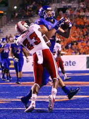 Boise State receiver Matt Miller is hit by Louisiana-Lafayette safety Tracy Walker on Sept. 20, 2014.