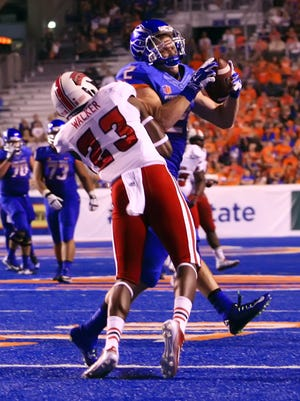 Boise State receiver Matt Miller is hit by Louisiana-Lafayette safety Tracy Walker at Albertsons Stadium on Sept. 20, 2014.