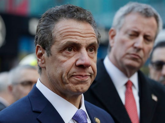 New York Gov. Andrew Cuomo, left, and Mayor Bill de Blasio don't agree on much, except charging extra for drivers to go south of 61st Street in Manhattan. Their plan for congestion pricing is under consideration in the New York state Legislature.