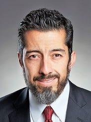Dr. Hector Flores, Western Heritage Bank board member.