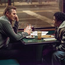 """Liam Neeson with Brian """"Astro"""" Bradley in a scene from the action thriller """"A Walk Among The Tombstones."""""""