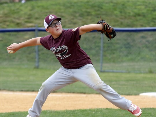Jack Carazzoni delivers a pitch for Elmira during an 8-1 win over Canandaigua in the 12-under division Thursday at the Cal Ripken Baseball Western New York State Championships at Pirozzolo Park in West Elmira.