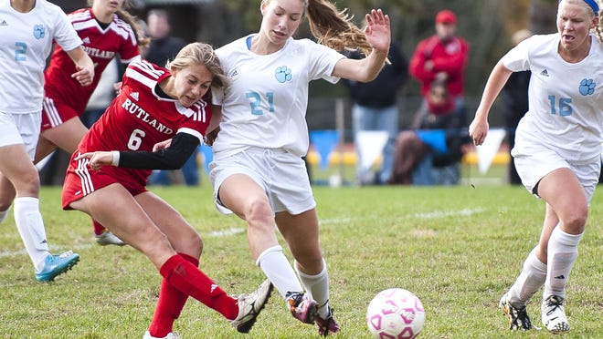 Rutland's Brooke Woodard, left, fires a shot past Mount Mansfield's Laura McKenzie (21) during the second half of Saturday's girls soccer playoff game in Jericho.