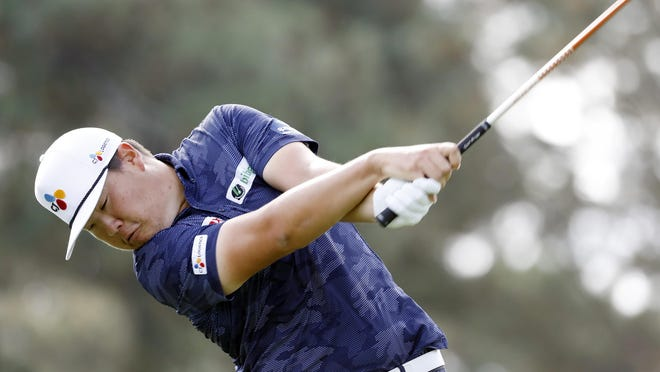Sungjae Im tees off on No. 3 during the final round of the Masters Tournament on Sunday. The Korean cut a four-shot deficit to one after five holes, but could get no closer to champion Dustin Johnson.
