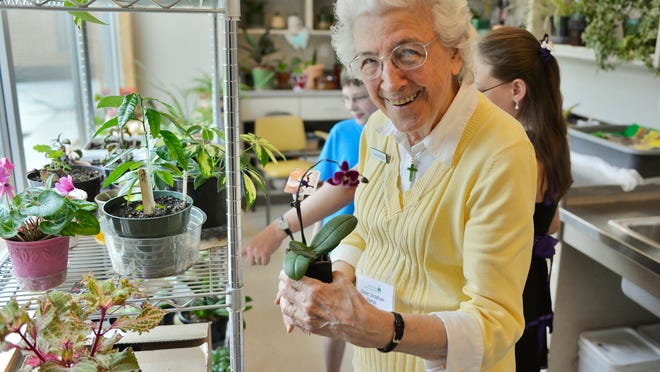 Sister Jonathan Herda shows off some of the plants in the new plant room during an open house June 22 at the Ramsey-Kaproth Wellness Center at St. Scholastic Convent.