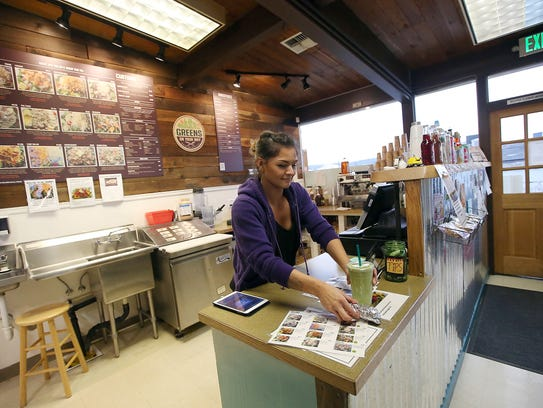 Ashley Sandoval serves up a smoothie at Greens On Your Way in Silverdale last week.