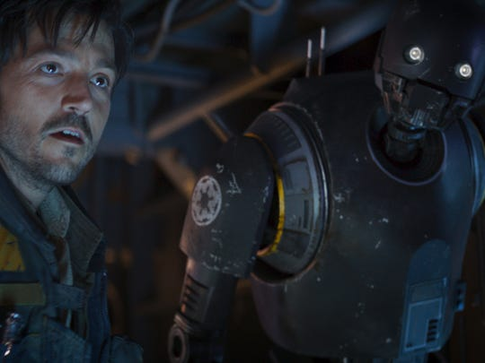 Rebel intelligence officer Cassian Andor (Diego Luna) and his droid buddy K-2SO (Alan Tudyk) in 'Rogue One: A Star Wars Story.'